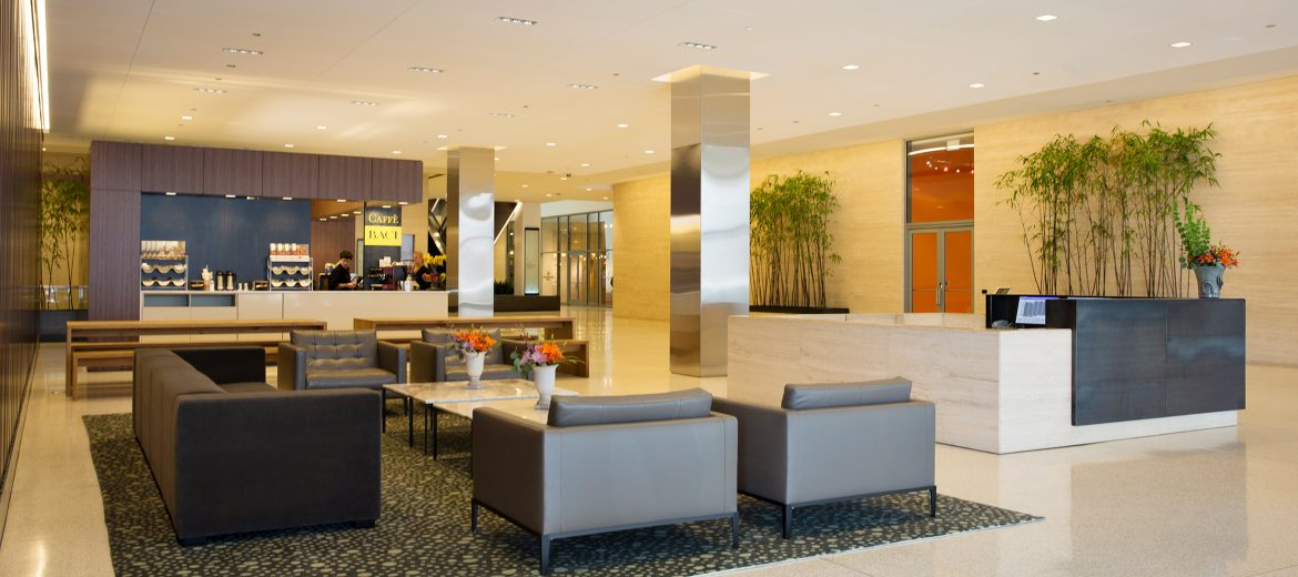 Major aspects of the lobby and common area project included a distinctive wood feature-wall separating the hotel access lobby from the office portion, and adding furniture and amenities to create a welcoming gathering space for tenants and their guests.