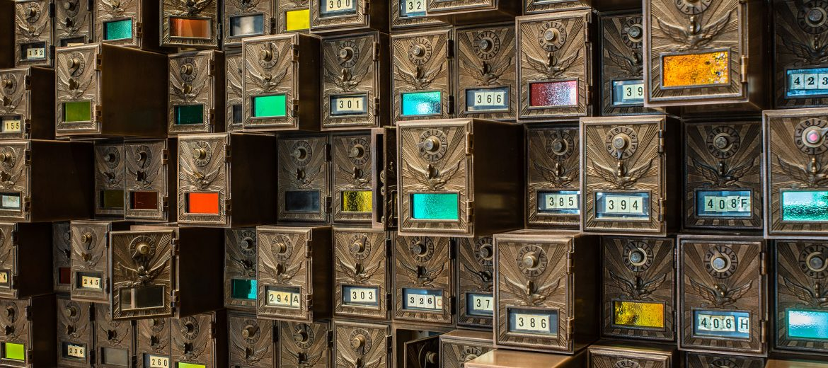 Repurposed 540 mailboxes and 25 brass panels as decorative artwork. Materials salvaged and incorporated into the renovation avoided many tons of landfill waste and preserved distinctive elements of the building's original use.